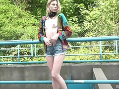 Skinny blonde solo girl Milena Devi enjoys playing in outdoors