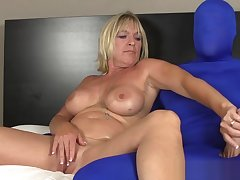Busty mature slut wanks costumed mans cock