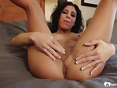 Smoking beauty shows off fingertips measurement close by pantyhose